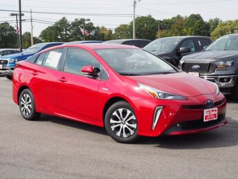 2021 Supersonic Red Toyota Prius LE Hatchback 1.8L 4 cyls Hybrid Engine Automatic (CVT) 4 Door
