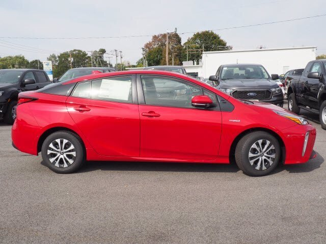 2021 Supersonic Red Toyota Prius LE Automatic (CVT) 4 Door 1.8L 4 cyls Hybrid Engine AWD