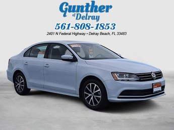 2017 White Silver Metallic Volkswagen Jetta 1.4T SE Intercooled Turbo Regular Unleaded I-4 1.4 L/85 Engine 4 Door Sedan