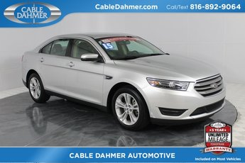2015 Ingot Silver Metallic Ford Taurus SEL FWD 3.5L 6-Cylinder SMPI DOHC Engine 4 Door Automatic