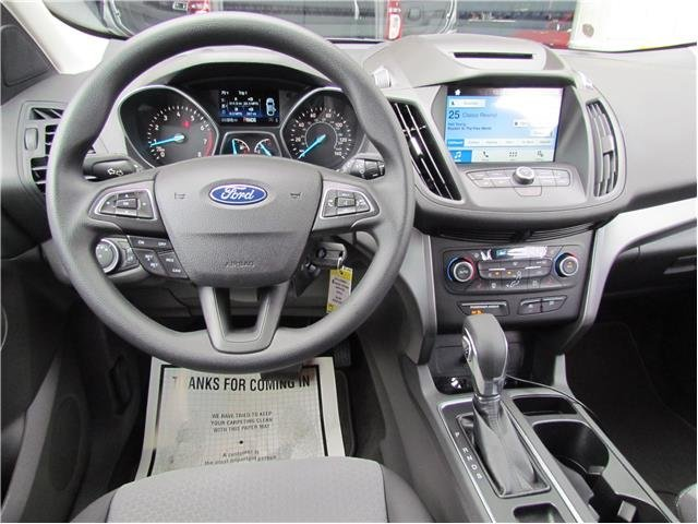 2018 White Gold Metallic Ford Escape SE Intercooled Turbo Regular Unleaded I-4 1.5 L/91 Engine 4X4 Automatic 4 Door