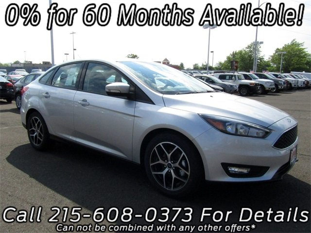 2018 Ingot Silver Metallic Ford Focus SEL FWD 2.0L I4 DGI Ti-VCT Engine 4 Door Automatic