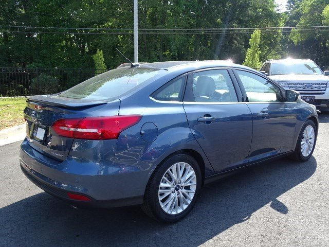 2018 Blue Metallic Ford Focus Titanium Sedan Regular Unleaded I-4 2.0 L/122 Engine Manual FWD 4 Door