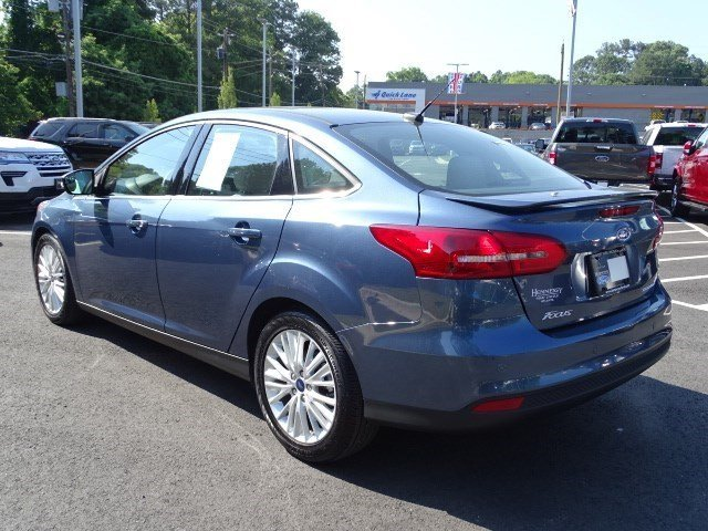 2018 Blue Metallic Ford Focus Titanium Sedan Regular Unleaded I-4 2.0 L/122 Engine FWD Manual 4 Door