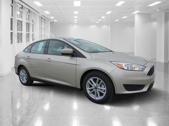 2018 White Gold Metallic Ford Focus SE Sedan 4 Door FWD Intercooled Turbo Regular Unleaded I-3 1.0 L/61 Engine Automatic