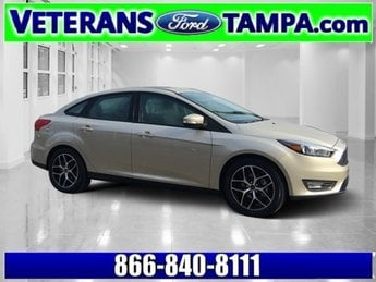 2018 White Gold Metallic Ford Focus SEL 4 Door Sedan Manual Regular Unleaded I-4 2.0 L/122 Engine FWD