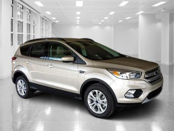 2018 White Gold Metallic Ford Escape SE Automatic Intercooled Turbo Regular Unleaded I-4 1.5 L/91 Engine 4 Door SUV 4X4