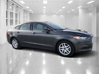 2015 Gray Ford Fusion SE Automatic Intercooled Turbo Regular Unleaded I-4 1.5 L/91 Engine Sedan FWD 4 Door