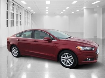 2014 Ruby Red Tinted Clearcoat Ford Fusion SE Intercooled Turbo Regular Unleaded I-4 1.5 L/91 Engine Automatic 4 Door FWD Sedan