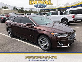 2019 Rich Copper Metallic Tinted Clearcoat Ford Fusion Hybrid Titanium Sedan 4 Door I4 Engine Automatic (CVT)