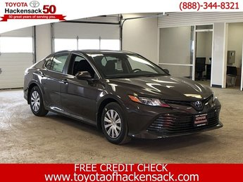 2019 Brownstone Toyota Camry Hybrid LE CVT Automatic (CVT) Sedan 4 Door Gas/Electric I-4 2.5 L/152 Engine FWD