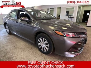 2019 Predawn Gray Mica Toyota Camry Hybrid LE CVT Sedan FWD Gas/Electric I-4 2.5 L/152 Engine Automatic (CVT)