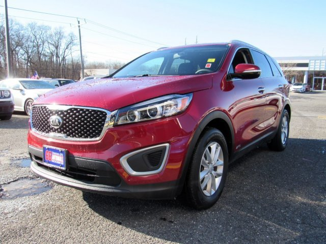 2016 Remington Red Kia Sorento LX Regular Unleaded I-4 2.4 L/144 Engine 4 Door SUV Automatic AWD