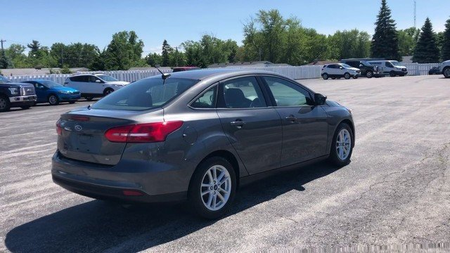 2017 Magnetic Metallic Ford Focus SE Sedan FWD 2.0L 4-Cyl Engine