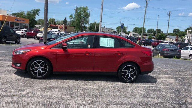2018 Hot Pepper Red Metallic Tinted Clearcoat Ford Focus SEL Automatic 2.0L I-4 GDI Ti-VCT Engine FWD 4 Door Sedan