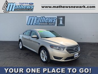 2018 White Gold Metallic Ford Taurus SEL 4 Door FWD 3.5 L 6-Cylinder Engine Automatic
