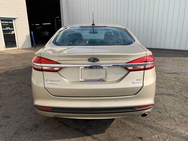 2017 PALLADIUM_WHITE_GO Ford Fusion SE Sedan Automatic 1.5 L 4-Cylinder Engine FWD 4 Door