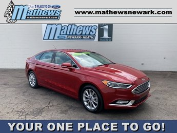 2017 Ruby Red Metallic Tinted Clearcoat Ford Fusion SE FWD Car 1.5 L 4-Cylinder Engine