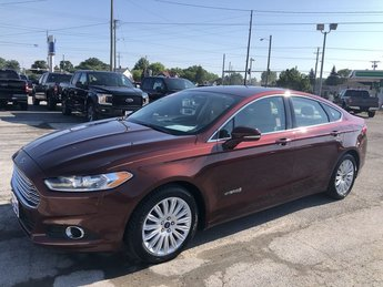 2016 Bronze Fire Metallic Tinted Clearcoat Ford Fusion SE Hybrid Automatic 4 Door Sedan 2.0L IVCT Atkinson Cycle I-4 Hybrid Engine FWD
