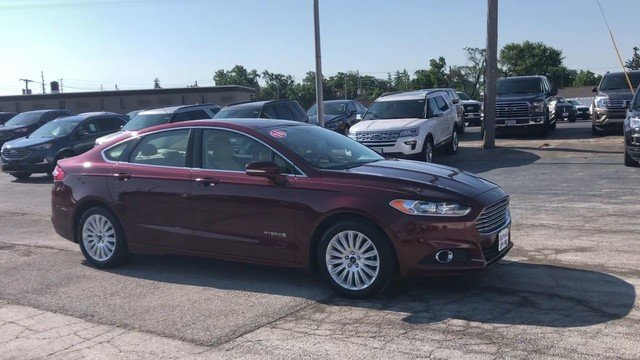 2016 Bronze Fire Metallic Tinted Clearcoat Ford Fusion SE Hybrid Automatic FWD 4 Door Sedan 2.0L IVCT Atkinson Cycle I-4 Hybrid Engine
