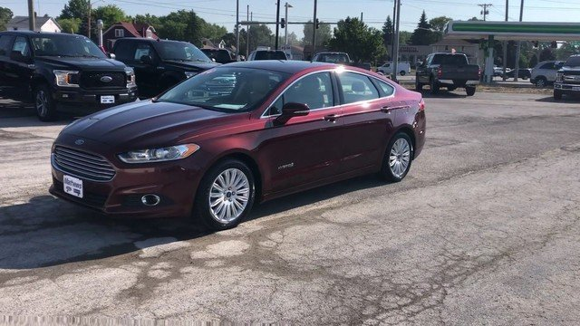 2016 Bronze Fire Metallic Tinted Clearcoat Ford Fusion SE Hybrid FWD 4 Door Automatic 2.0L IVCT Atkinson Cycle I-4 Hybrid Engine