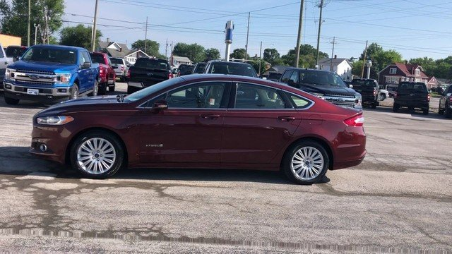 2016 Bronze Fire Metallic Tinted Clearcoat Ford Fusion SE Hybrid 4 Door Automatic Sedan FWD