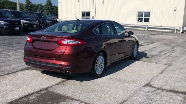 2016 Bronze Fire Metallic Tinted Clearcoat Ford Fusion SE Hybrid FWD 4 Door Sedan 2.0L IVCT Atkinson Cycle I-4 Hybrid Engine Automatic